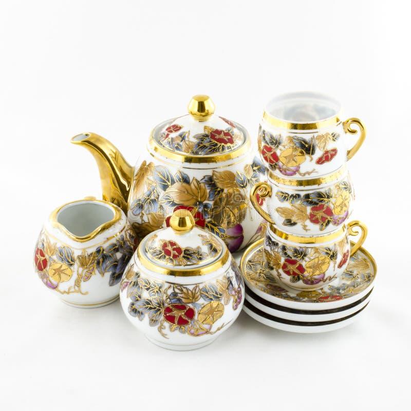 古色古香的瓷茶和coffe设置了与花主题 库存图片