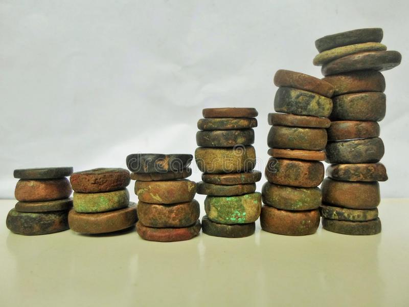 古色古香的石硬币图表 库存图片