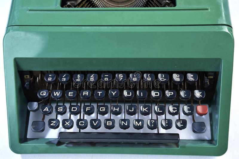 古色古香的绿色打字机,类推键入 免版税库存图片