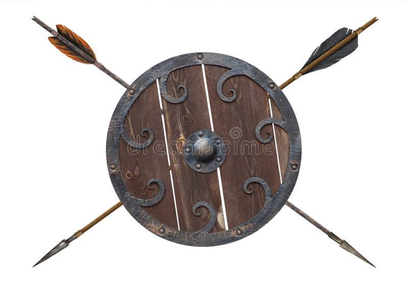 古色古香的老箭头和盾 图库摄影