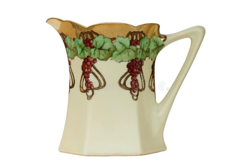 古色古香的葡萄手画查出的汁投手 图库摄影
