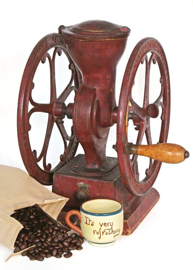 古色古香的豆咖啡杯研磨机轮子 库存图片