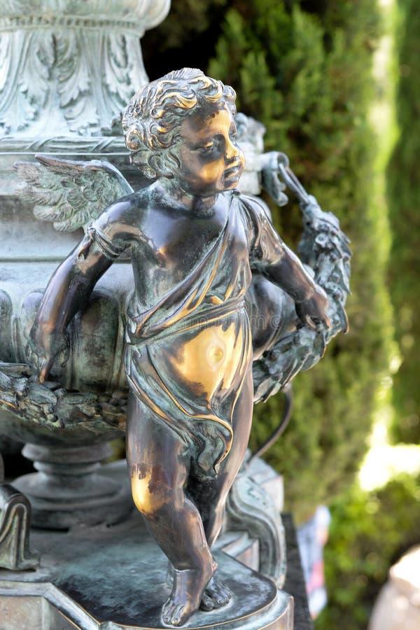 古铜色天使小雕象 库存图片