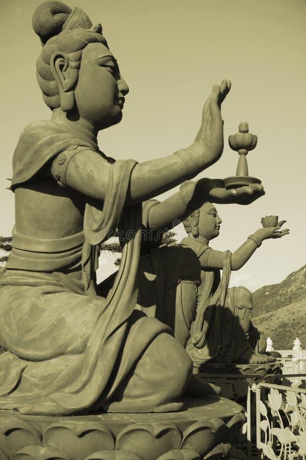 古铜色神仙的香港雕象 库存图片