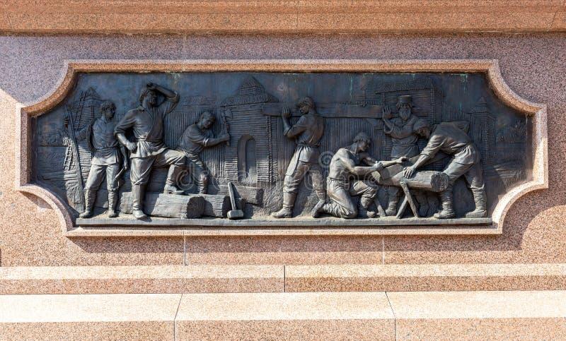 古铜色纪念碑细节对翼果的创建者的- Grig王子 图库摄影