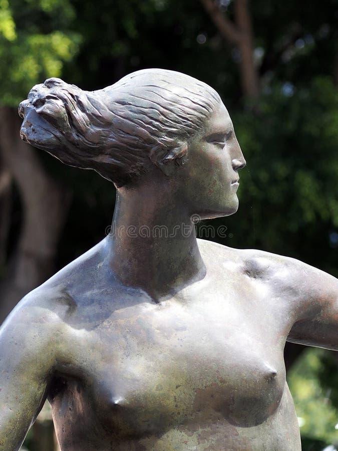 古铜色雕象,女性 库存图片