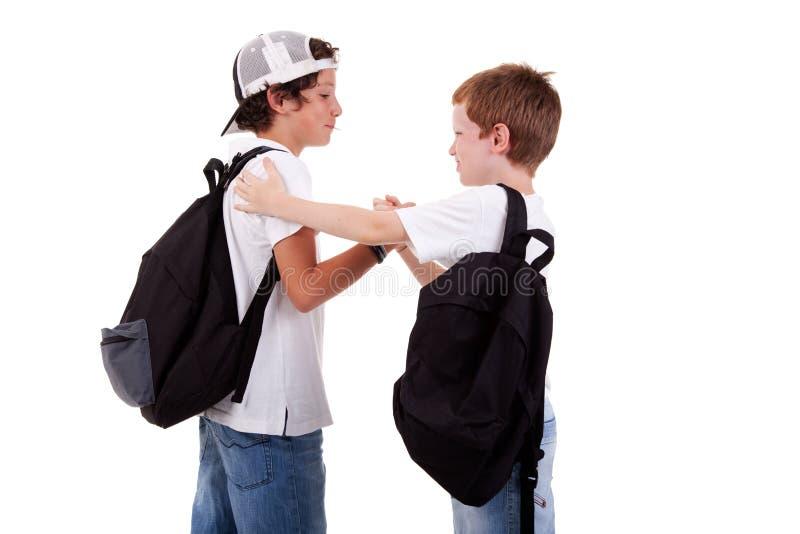 另一所男孩去的问候一学校 库存照片