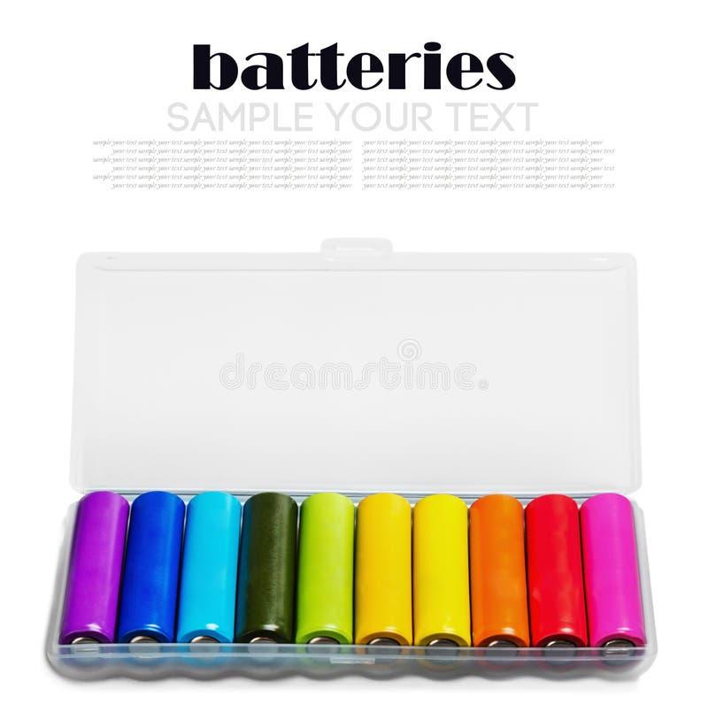 另外颜色碱性电池或可再充电电池 免版税图库摄影