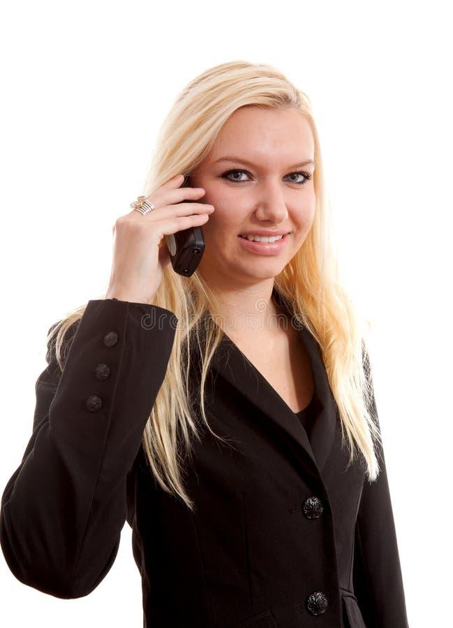 叫白肤金发的女实业家电话 库存图片
