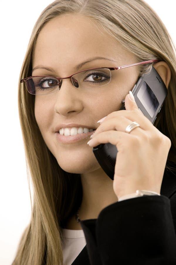 叫的女实业家移动电话 免版税图库摄影