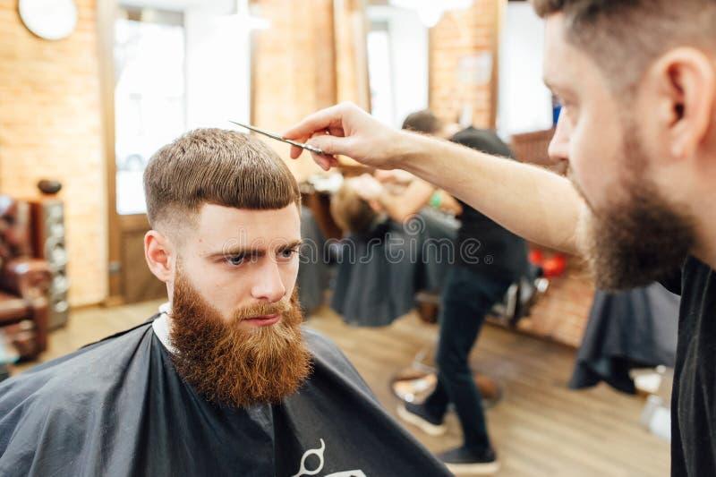 可及时髦理发的人理发店 库存照片