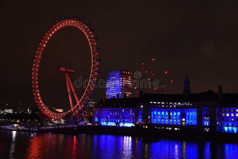 可口可乐伦敦眼轮子夜视图 库存图片
