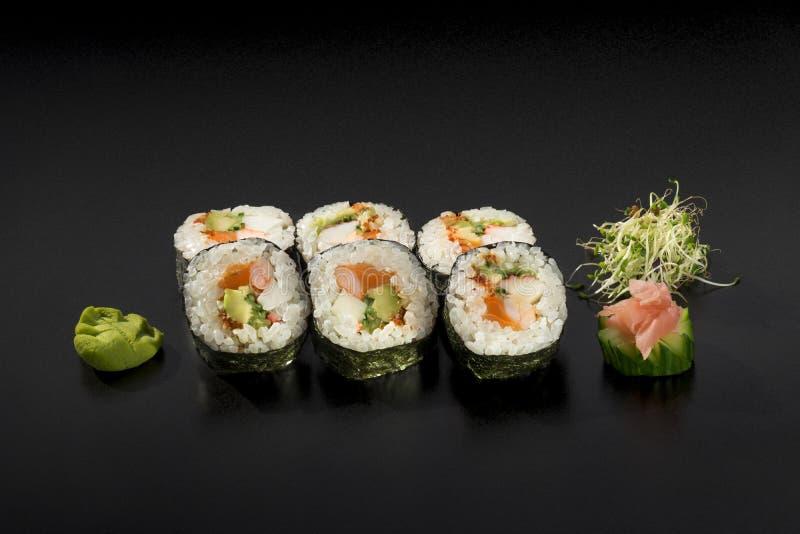 可口集合日本寿司卷 库存照片