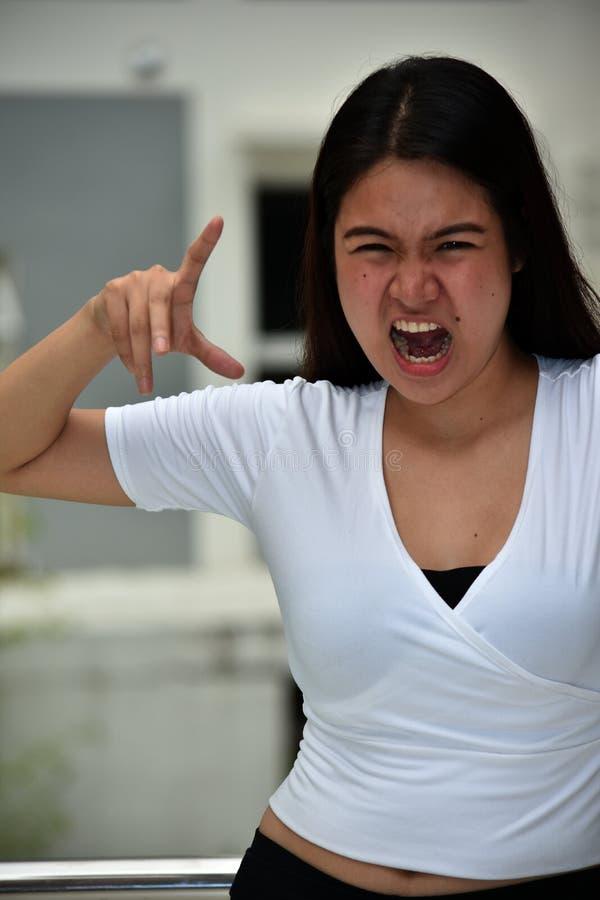可怕俏丽的亚裔女性 免版税库存图片