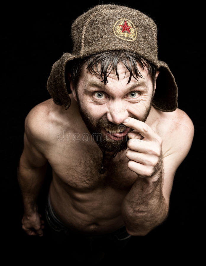 可怕邪恶的阴险有胡子的人黑暗的画象有假笑的,做各种各样的手的标志并且表现出不同的情感 免版税库存照片