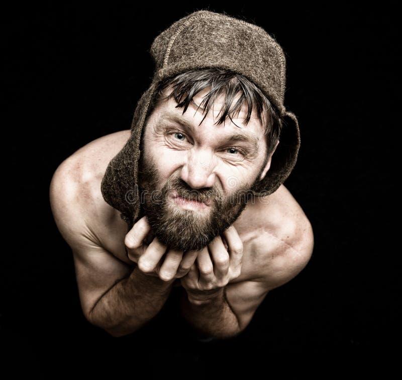 可怕邪恶的阴险有胡子的人黑暗的画象有假笑的,做各种各样的手的标志并且表现出不同的情感 库存图片