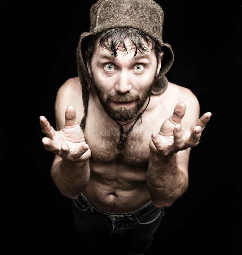 可怕邪恶的阴险有胡子的人黑暗的画象有假笑的,做各种各样的手的标志并且表现出不同的情感 免版税库存图片