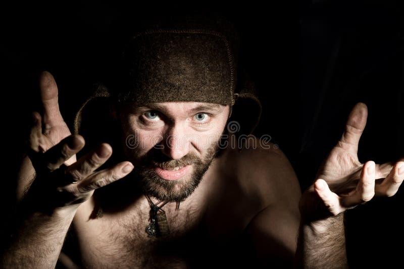 可怕邪恶的阴险有胡子的人黑暗的画象有假笑的,做各种各样的hand& x27; s签署并且表现出不同的情感 免版税库存图片