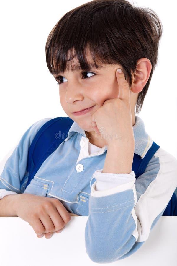 可爱男孩纵向学校认为 免版税库存图片