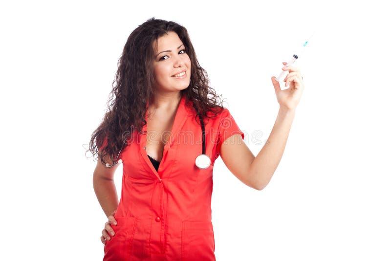 可爱的医生护士注射器妇女 免版税库存图片