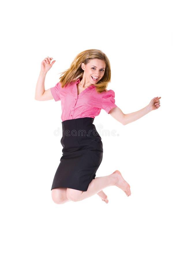 可爱的女实业家跳衬衣胜利 库存图片