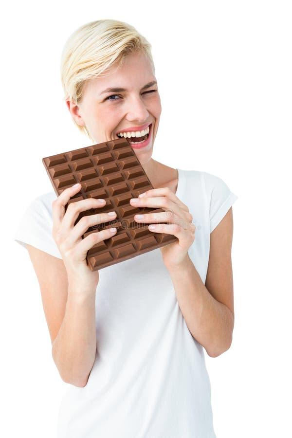 可爱的妇女尖酸的巧克力 免版税库存照片