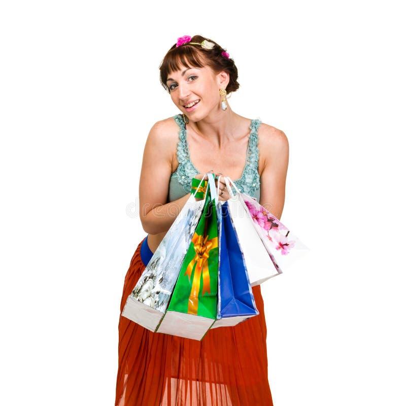 可爱的妇女的图片有购物袋的 免版税库存图片