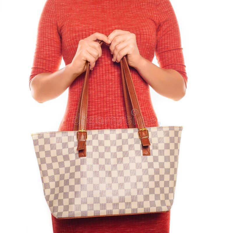 可爱的妇女的图片红色礼服的有方格的袋子的 库存照片