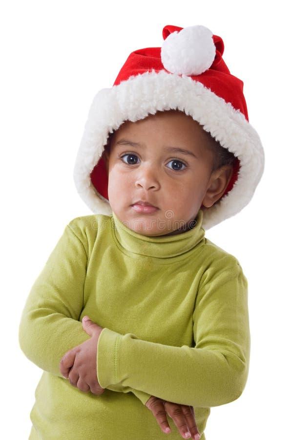可爱的婴孩圣诞节女孩帽子红色 免版税库存图片