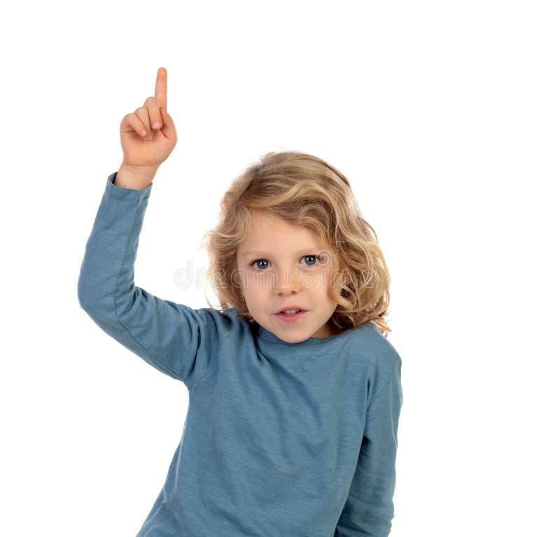 可爱的孩子用他的手提高了要求讲话 免版税库存照片