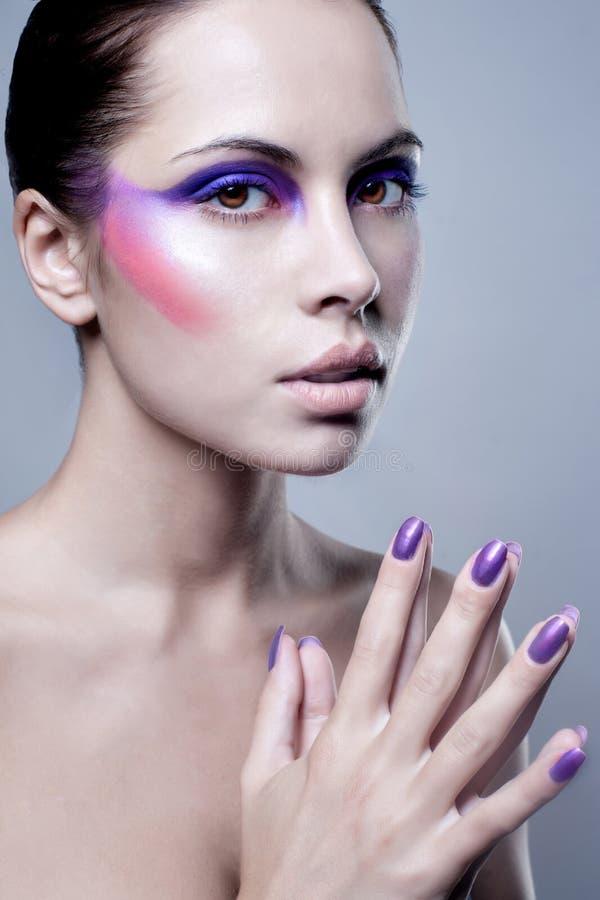 可爱的少妇画象有五颜六色的构成的在面孔 图库摄影