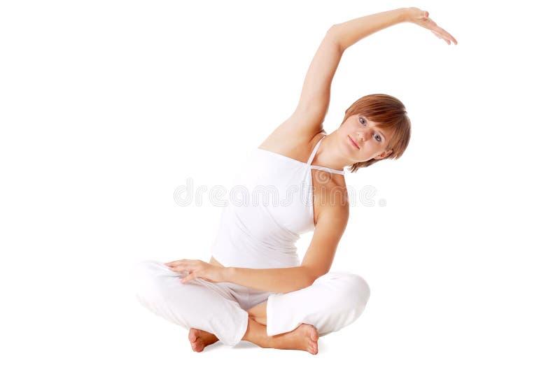 可爱的执行的舒展的妇女 免版税库存图片
