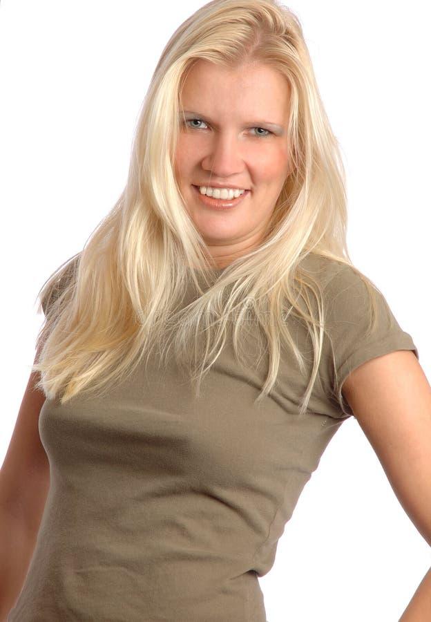 可爱的新白肤金发的妇女 免版税库存照片