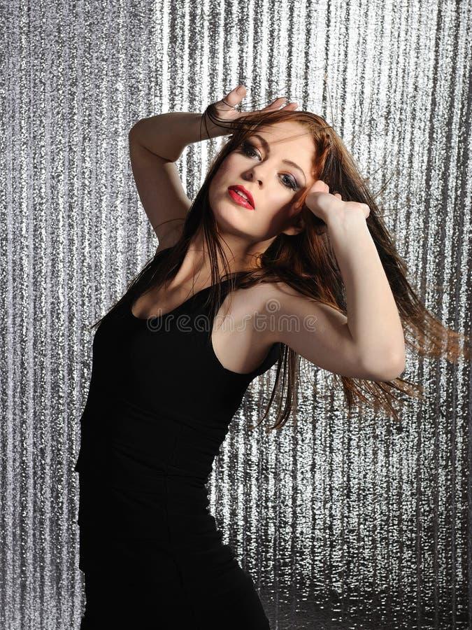 可爱的棍打的跳舞迪斯科性感的妇女 免版税图库摄影