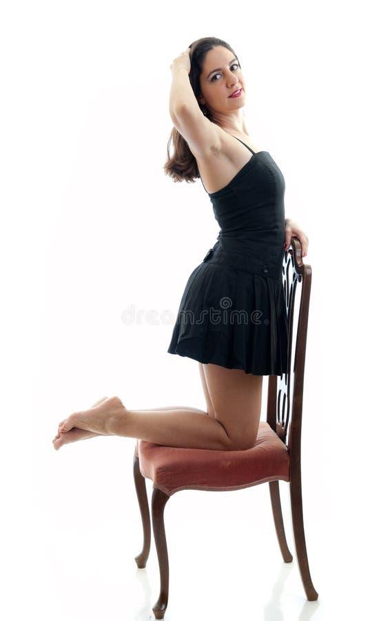 可爱的椅子女孩 库存图片