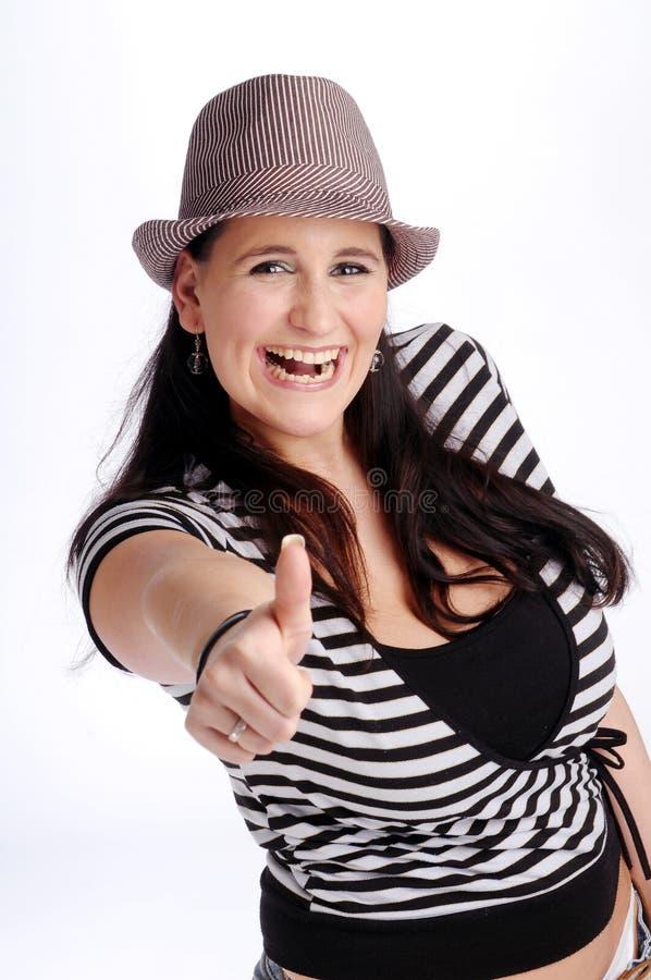 可爱的深色的帽子妇女 图库摄影