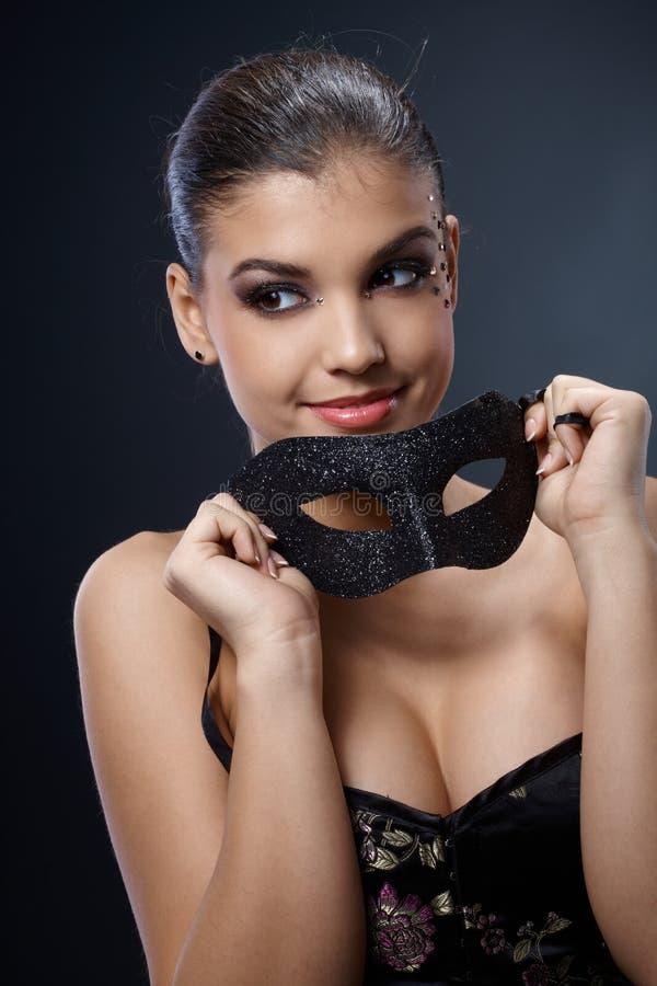 可爱的狂欢节屏蔽妇女 免版税库存照片