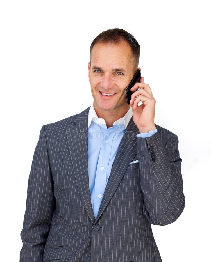 可爱的生意人移动电话使用 免版税图库摄影