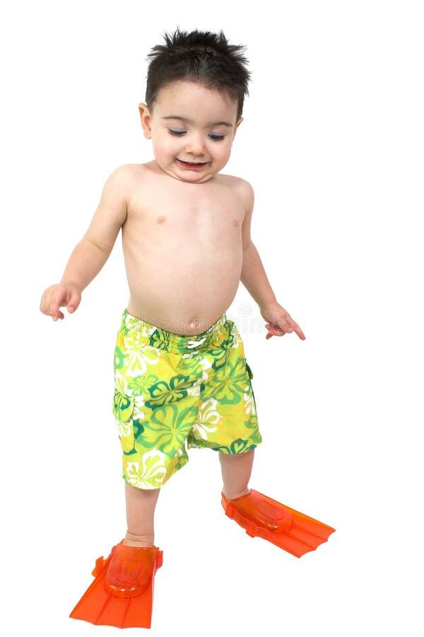 可爱的男孩明亮的鸭脚板他橙色准备游泳 库存图片