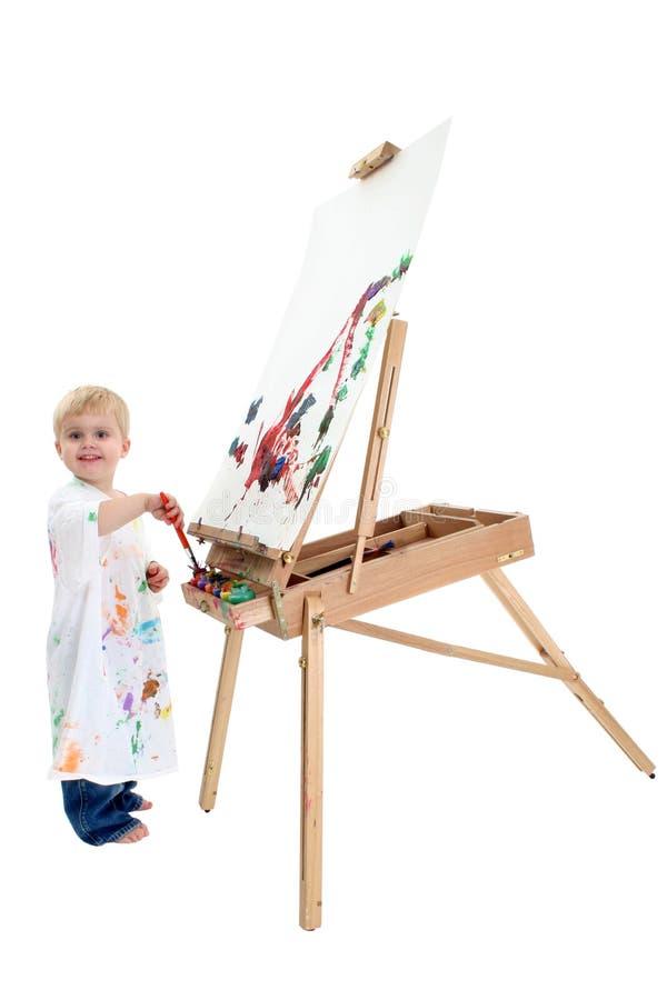 可爱的男孩画架绘画小孩 免版税库存照片
