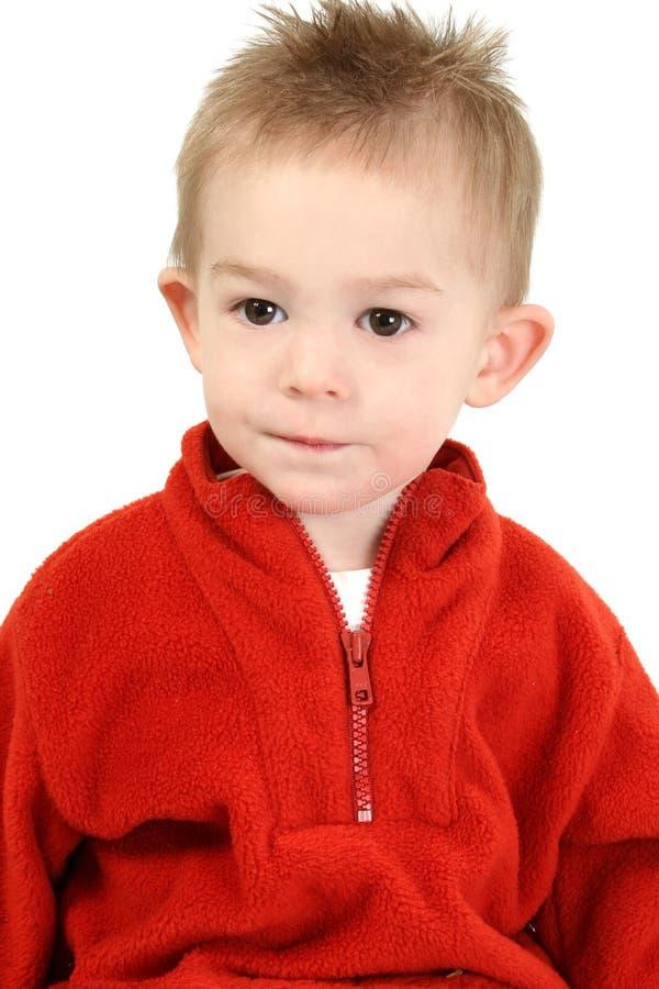 可爱的男孩老一红色毛线衣年 图库摄影