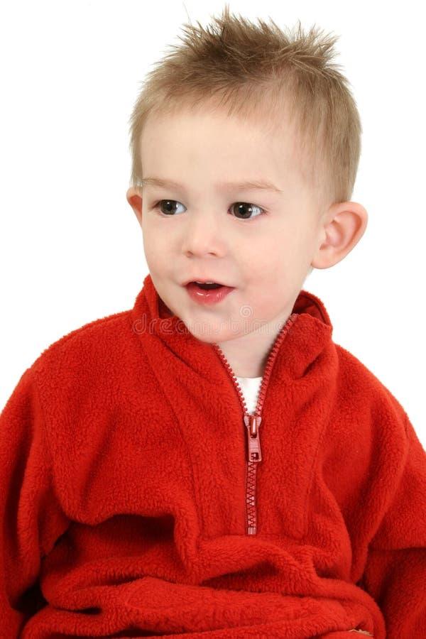 可爱的男孩老一红色毛线衣年 库存照片