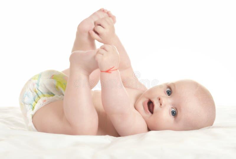 可爱的男婴纵容 免版税库存图片