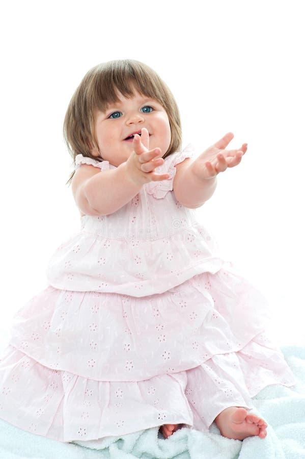 可爱的白肤金发的婴孩请求她的玩具 免版税库存照片