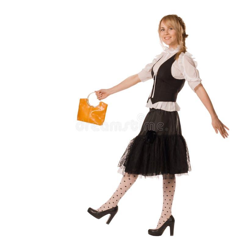 可爱的袋子女孩去黄色 免版税库存照片