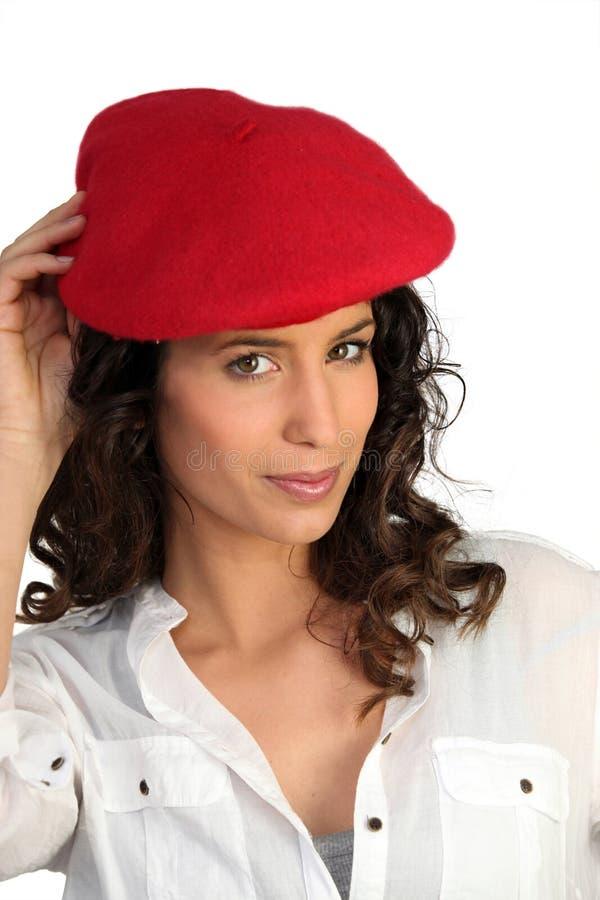 可爱的贝雷帽妇女 库存照片
