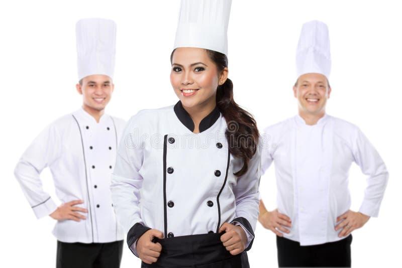 可爱的年轻厨师队 免版税库存图片