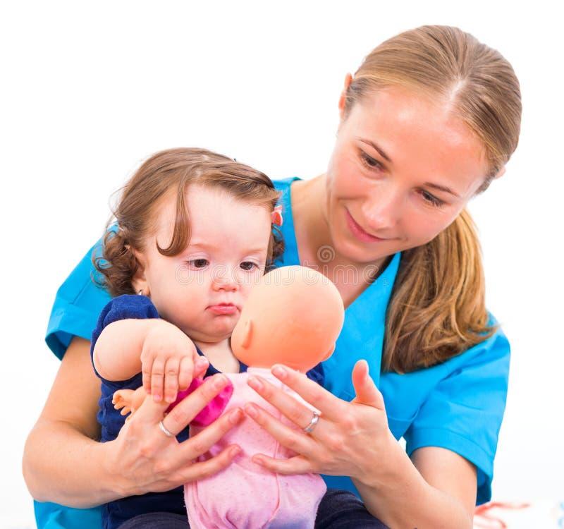 可爱的婴孩和保姆 库存图片