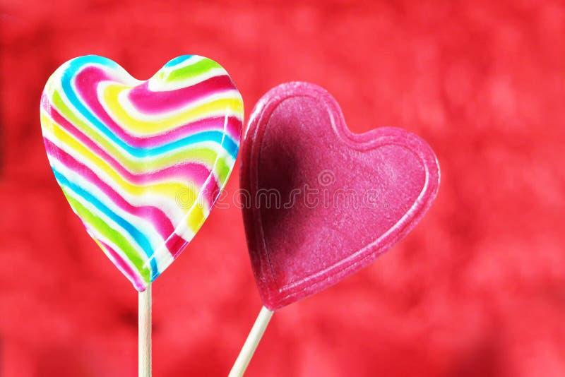 可用的看板卡日文件华伦泰向量 心脏糖果棒棒糖 免版税库存图片