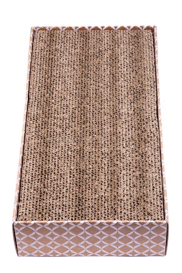 可逆猫scratcher被隔绝的由100%被回收的纸板制成在白色背景 抓的猫纸玩具 免版税库存照片
